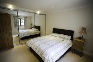 Double bed and mirrored wardrobes